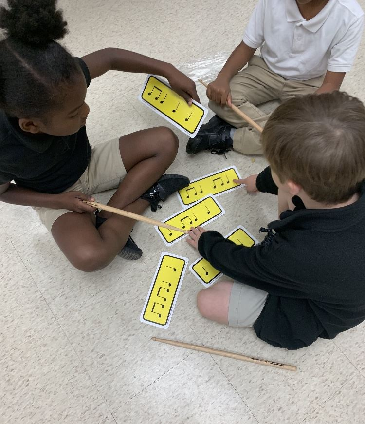 Students work on identifying music notes in class.