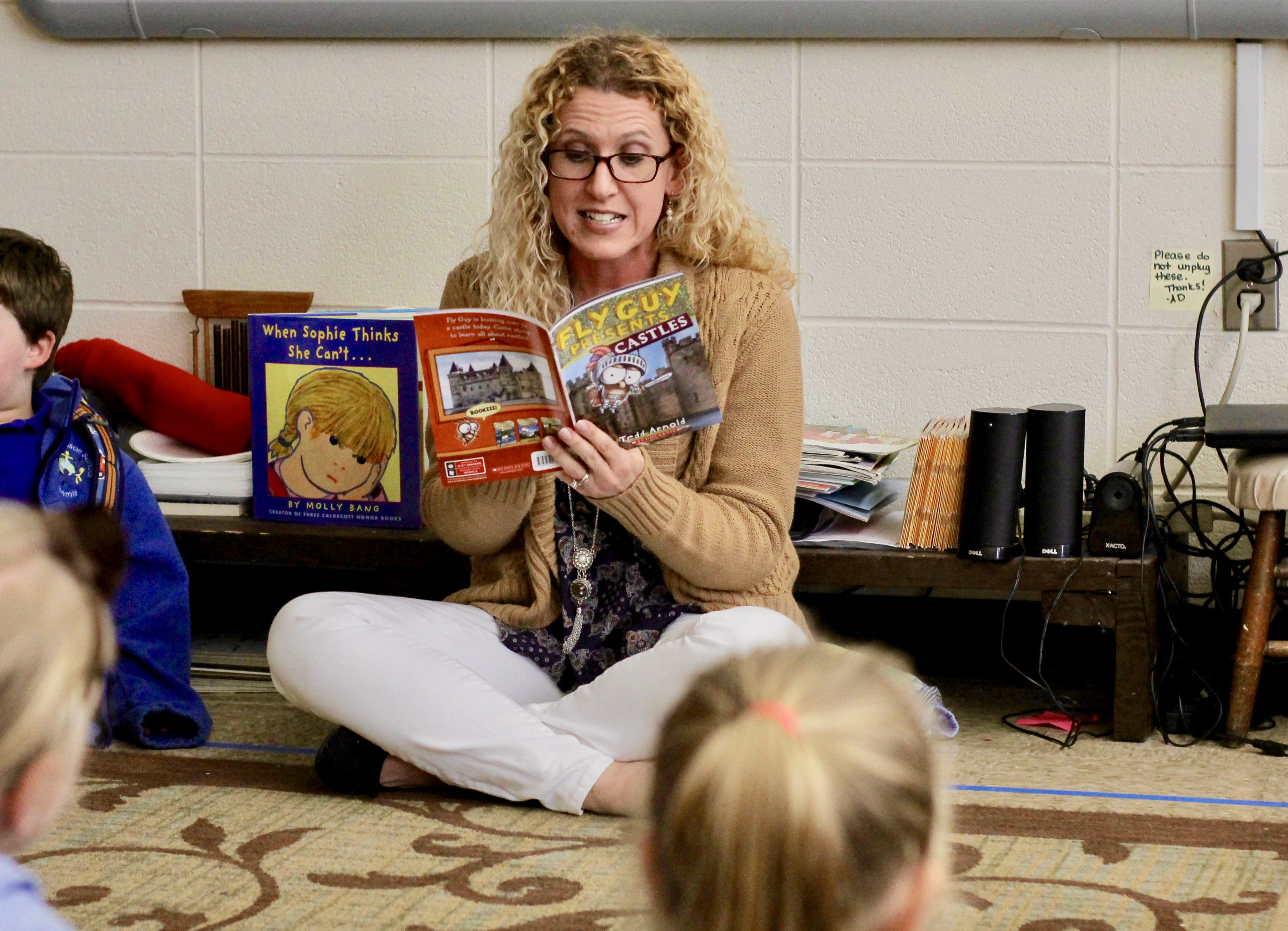 Teacher Ayme Davis reads to her students.