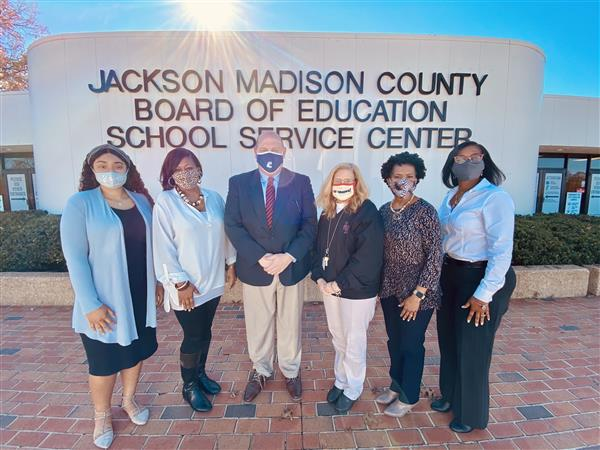 JMCSS operations staff out front on a sunny day.