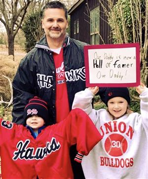 Coach Wyatt and his children are excited for his upcoming induction into the Madison County Sports Hall of Fame.