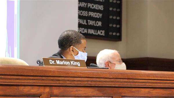 Dr. King and board member Campbell during 7/9 Board Meeting.