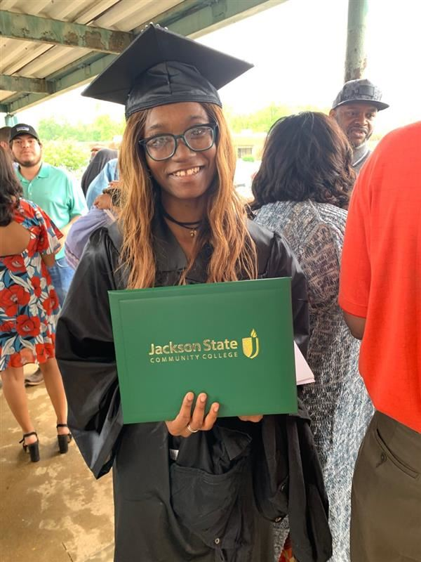 Student with Jackson State Diploma