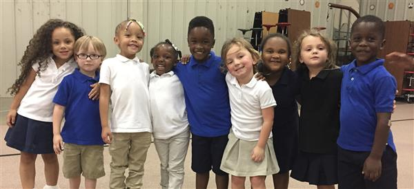 Pre-K Students smile for the camera