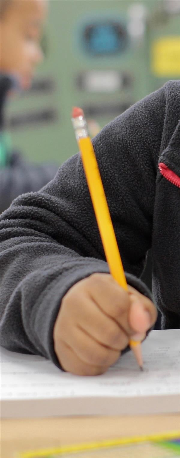 Student holds a pencil
